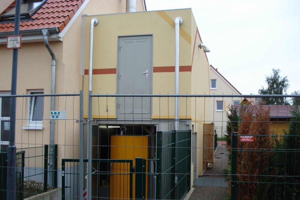 Pelletanlage-300-kW im Container Putzfassade